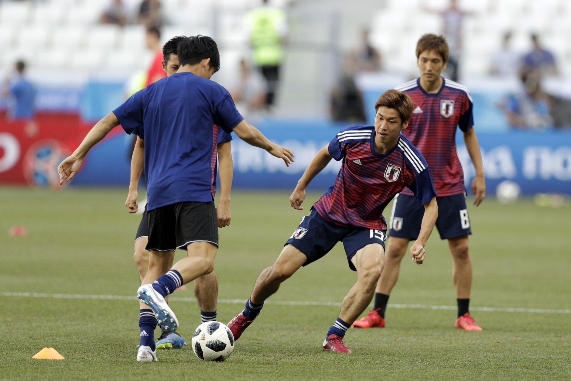 Japanese players warm up ahead of the group H match between Japan and Poland at the 2018 soccer World Cup at the Volgograd Arena in Volgograd, Russia, Thursday, June 28, 2018. (AP Photo/Andrew Medichini)