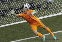 Japan goalkeeper Eiji Kawashima dives to stop a shot right over the goal line during the group H match between Japan and Poland at the 2018 soccer World Cup at the Volgograd Arena in Volgograd, Russia, Thursday, June 28, 2018. (AP Photo/Themba Hadebe)