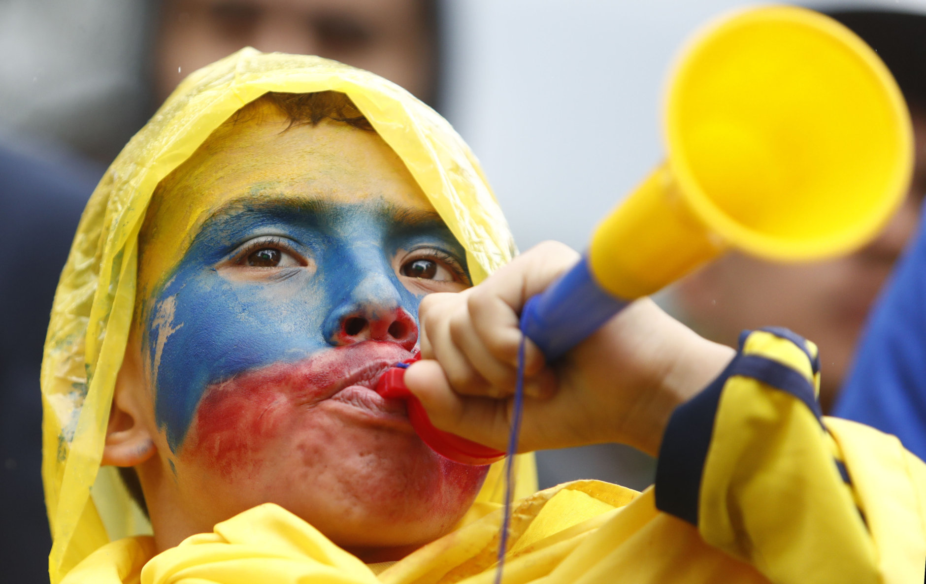 A Colombia soccer fan watches an outdoor live telecast of the group H match between Senegal and Colombia, at the 2018 soccer World Cup, in Bogota, Colombia, Thursday, June 28, 2018. (AP Photo/Daniel Munoz)