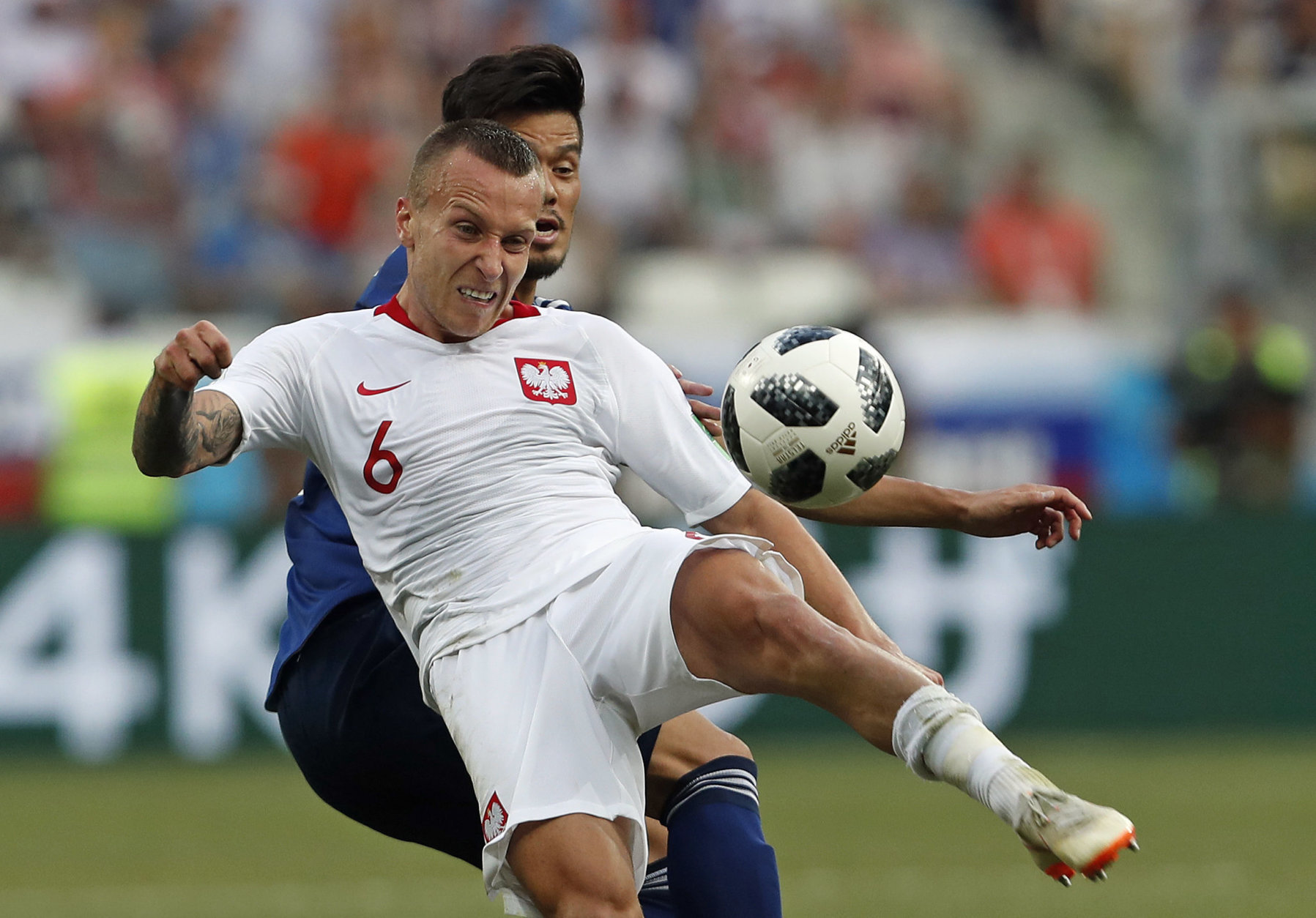 Poland's Jacek Goralski clears the ball during the group H match between Japan and Poland at the 2018 soccer World Cup at the Volgograd Arena in Volgograd, Russia, Thursday, June 28, 2018. (AP Photo/Darko Vojinovic)