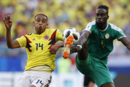 Colombia's Luis Muriel, left, and Senegal's Salif Sane challenge for the ball during the group H match between Senegal and Colombia, at the 2018 soccer World Cup in the Samara Arena in Samara, Russia, Thursday, June 28, 2018. (AP Photo/Efrem Lukatsky)