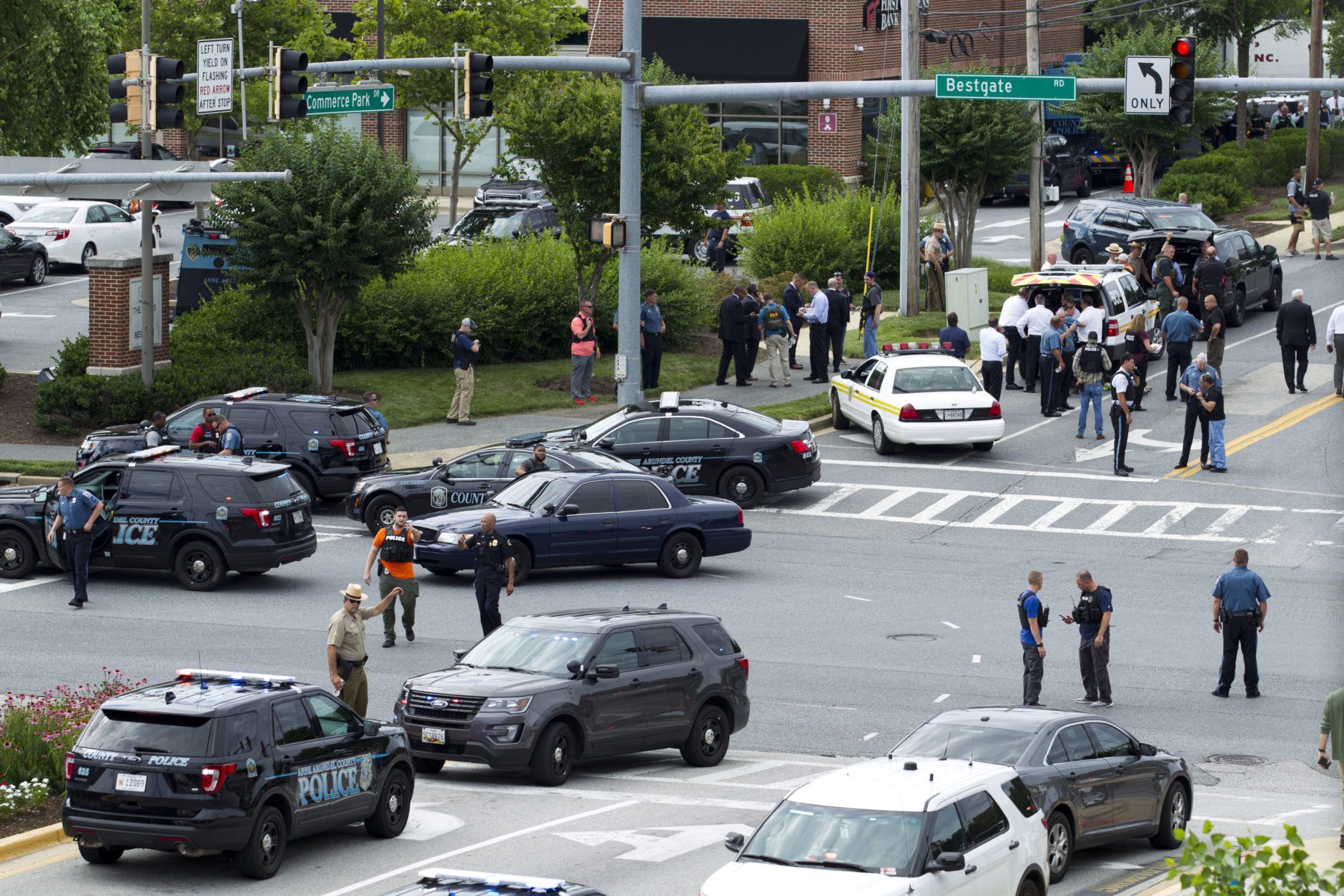 Maryland police officers block the intersection at the building entrance, after multiple people were shot at a newspaper in Annapolis, Md., Thursday, June 28, 2018. (AP Photo/Jose Luis Magana)