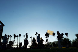 TV crews waiting for a news conference line up at the side of the road across the newspaper office building where multiple people were shot this afternoon inside of the newsroom, in Annapolis, Md., Thursday, June 28, 2018. (AP Photo/Jose Luis Magana)