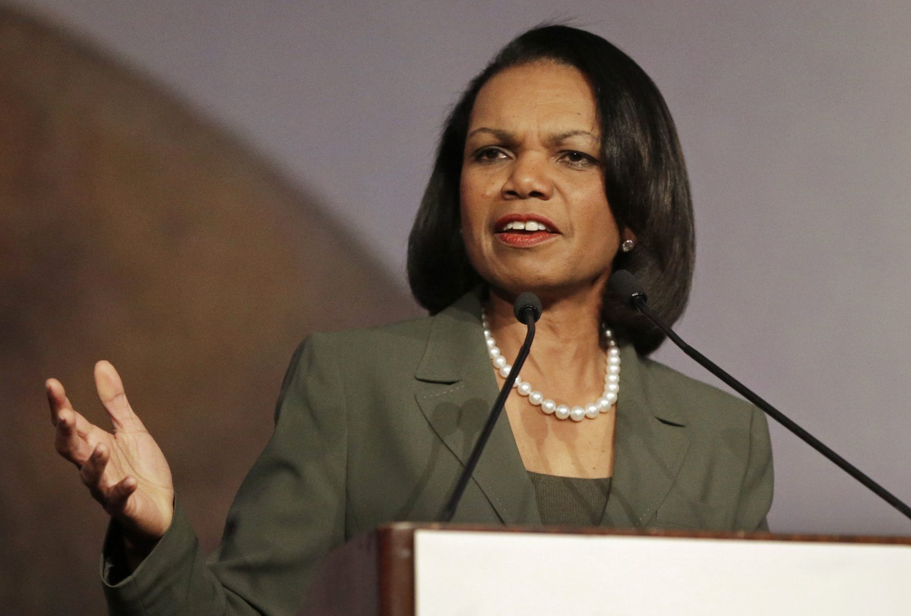 FILE - In this March 15, 2014 file photo, former Secretary of State Condoleezza Rice gestures while speaking at the California Republican Party 2014 Spring Convention in Burlingame, Calif.  University of Minnesota faculty and student activists are pressuring the school to rescind its invitation to Rice to speak at the Twin Cities campus April 17 as part of the Humphrey School of Public Affairs' lecture series. Math professor William Messing has introduced a resolution to be considered by the University Senate next week which asks that the Rice speech be canceled because of her role in the wartime policies of the Bush administration.(AP Photo/Ben Margot, File)
