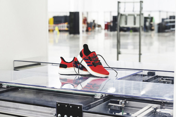 The red AM4NHL running shoe features the Capitals  logo on one side and the  Adidas brand 3-stripes on the other. (Courtesy Adidas) ed31233e04d9