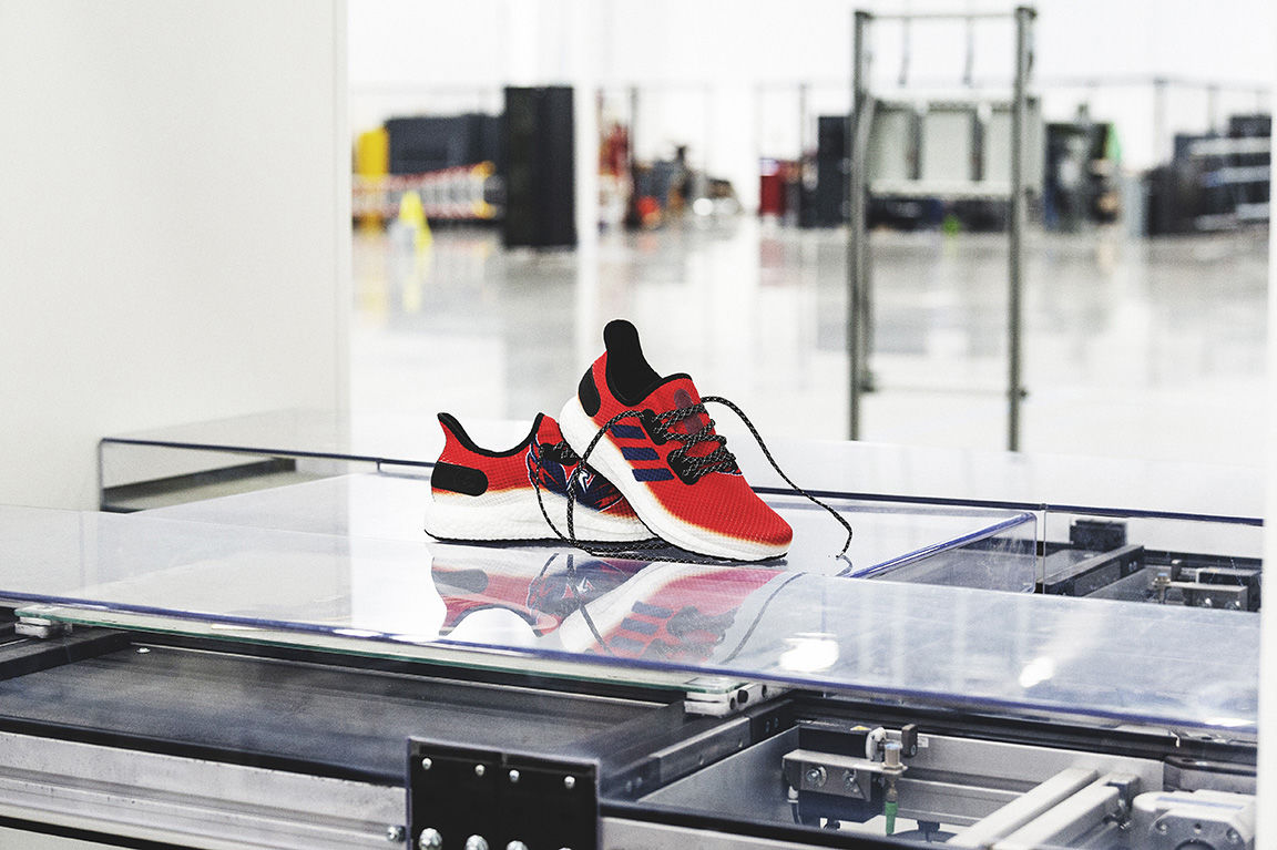 The red AM4NHL running shoe features the Capitals logo on one side and the Adidas brand 3-stripes on the other. (Courtesy Adidas)