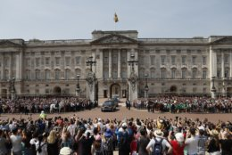 FILE - In this Wednesday, June 21, 2017 file photo, Queen Elizabeth II leaves Buckingham Palace with Prince Charles to travel to parliament for her speech at the official State Opening of Parliament in London. Queen Elizabeth II is costing British taxpayers a bit more this year. Financial figures published Thursday, June 28, 2018 reveal that overall costs have gone up in part because of a 10-year program to refit aging Buckingham Palace, the queen's official residence in central London.  (AP Photo/Frank Augstein, File)