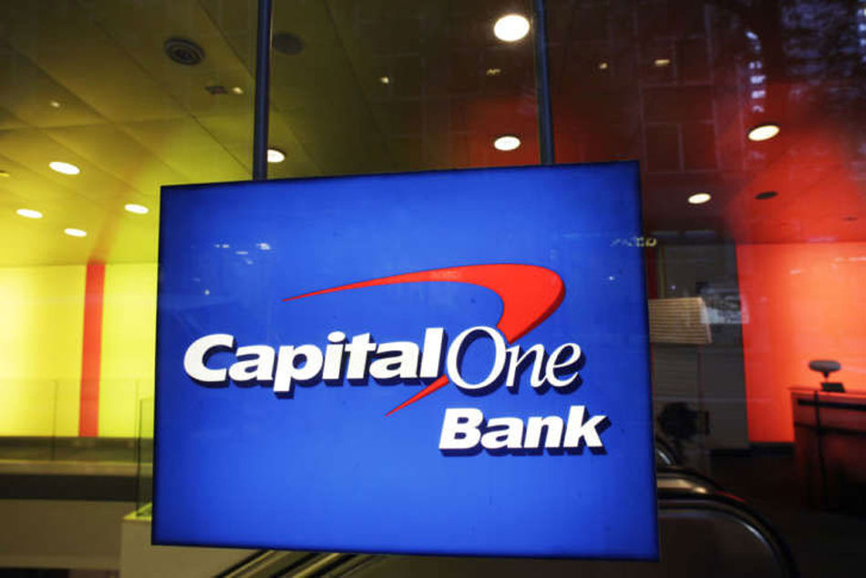Beginning next year, Capital One will be the exclusive issuer of Walmart's private label and co-branded credit cards in the U.S. (AP/Mark Lennihan)