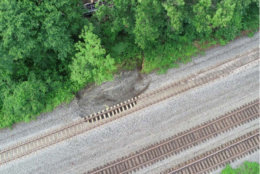 The rocks sat a foot and a half lower than they should have, and a mark on the rail showed that area was where cars slid off the tracks parallel to the Capital Beltway east of the Van Dorn Street Metro station. (Courtesy NTSB)