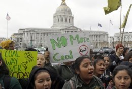 FILE - In this Feb. 28, 2018, file photo, students rally for clean energy in front of San Francisco City Hall. A U.S. judge who held a hearing about climate change that received widespread attention has thrown out the underlying lawsuits that sought to hold big oil companies liable for the role of fossil fuels in the Earth's warming environment. Judge William Alsup in San Francisco said Monday, June 25, 2018, that Congress and the president, not a federal judge, were best suited to address fossil fuels' contribution to global warming. (AP Photo/Jeff Chiu, File)