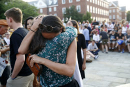 People hug as they gather for a vigil in response to a shooting in the Capital Gazette newsroom, Friday, June 29, 2018, in Annapolis, Md. Prosecutors say Jarrod W. Ramos opened fire Thursday in the newsroom. (AP Photo/Patrick Semansky)