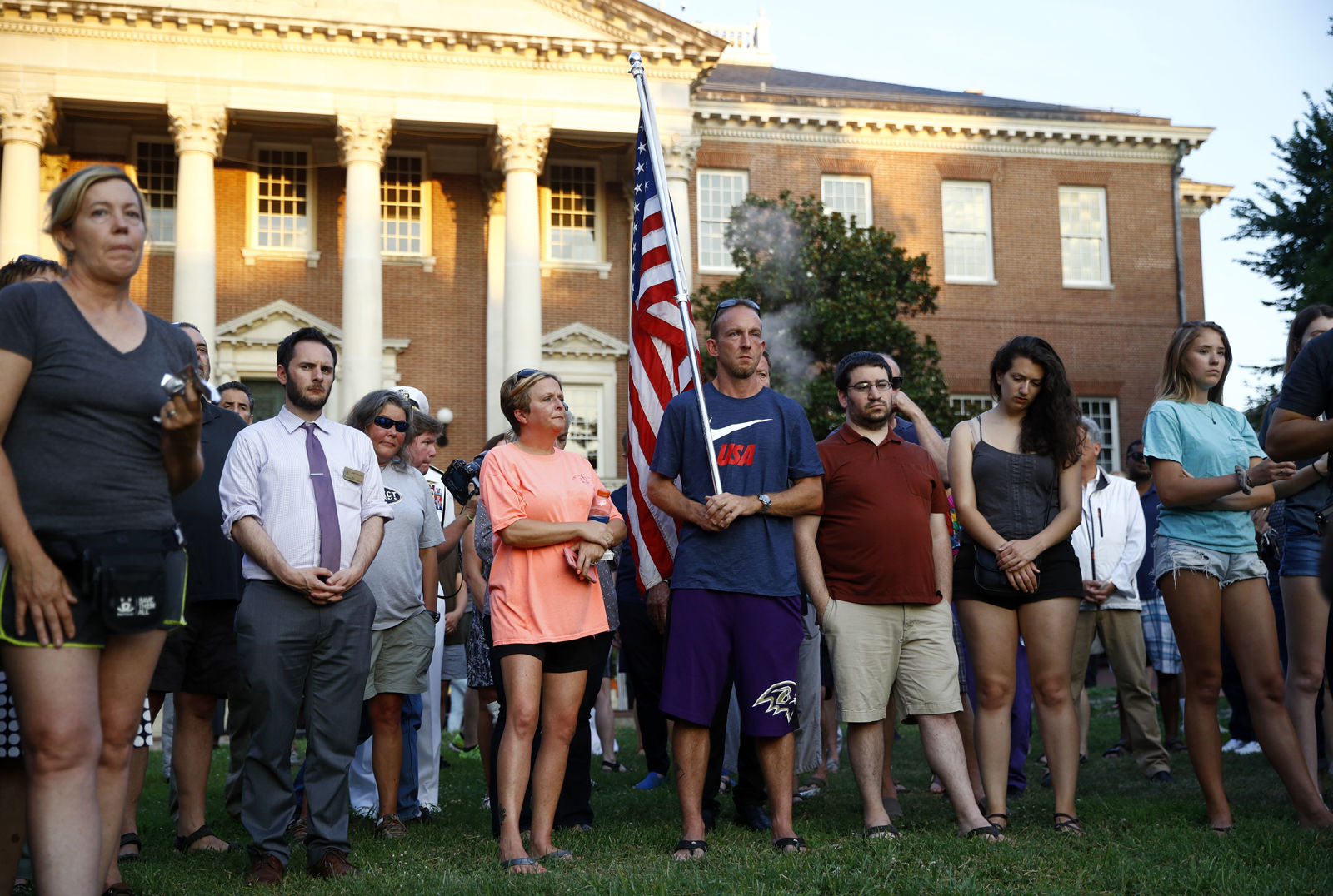 People gather for a vigil in response to a shooting at the Capital Gazette newsroom, Friday, June 29, 2018, in front of the Maryland State House in Annapolis, Md. Prosecutors say Jarrod W. Ramos opened fire Thursday in the newsroom. (AP Photo/Patrick Semansky)