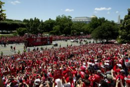 Fans cheers the Washington Capitals NHL hockey Stanley Cup championship team during a victory parade and rally at The National Mall, Tuesday, June 12, 2018, in Washington. (AP Photo/Jose Luis Magana)