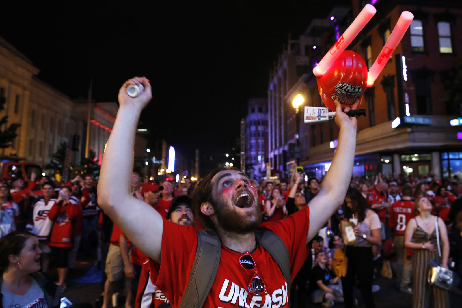 """Brian """"Buzz"""" Ganow, 22, of Manassas, Va., celebrates a goal in the second period of Game 3 of the NHL hockey Stanley Cup Final between the Washington Capitals and the Vegas Golden Knights, Saturday, June 2, 2018, in Washington. Fans could watch the game on a large screen outside the venue. """"I've lived here my whole life,"""" says Ganow, """"so I've been waiting for this for a long time."""" (AP Photo/Jacquelyn Martin)"""