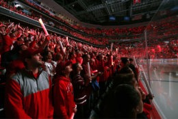 Washington Capitals fans wave glo-sticks before Game 3 of the NHL hockey Stanley Cup Final between the Capitals and the Vegas Golden Knights, Saturday, June 2, 2018, in Washington. (AP Photo/Alex Brandon)