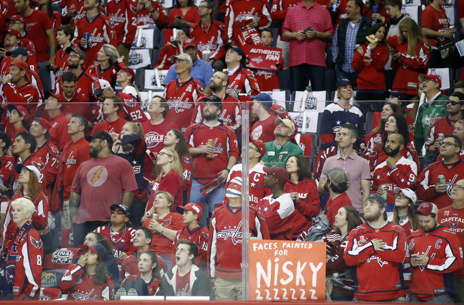 Washington Capitals fans wait for their team to warm up before Game 3 of the NHL hockey Stanley Cup Final between the Capitals and the Vegas Golden Knights, Saturday, June 2, 2018, in Washington. (AP Photo/Alex Brandon)