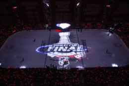 The logo for the Stanley Cup Final series is projected on the ice before Game 3 of the NHL hockey Stanley Cup Final between the Washington Capitals and the Vegas Golden Knights, Saturday, June 2, 2018, in Washington. (AP Photo/Alex Brandon)
