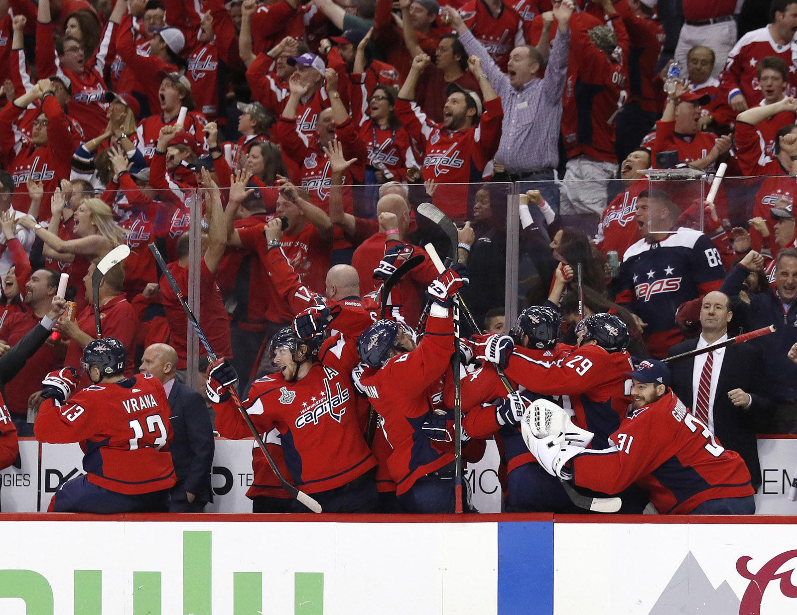 Fans and Washington Capitals players celebrate a goal by Capitals forward Devante Smith-Pelly during the third period in Game 3 of the NHL hockey Stanley Cup Final against the Vegas Golden Knights, Saturday, June 2, 2018, in Washington. (AP Photo/Alex Brandon)