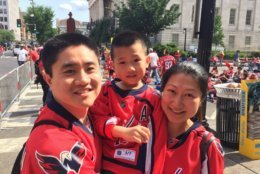 The Liang family wait for the puck to drop outside Capital One Arena on Thursday. (WTOP/Kristi King)