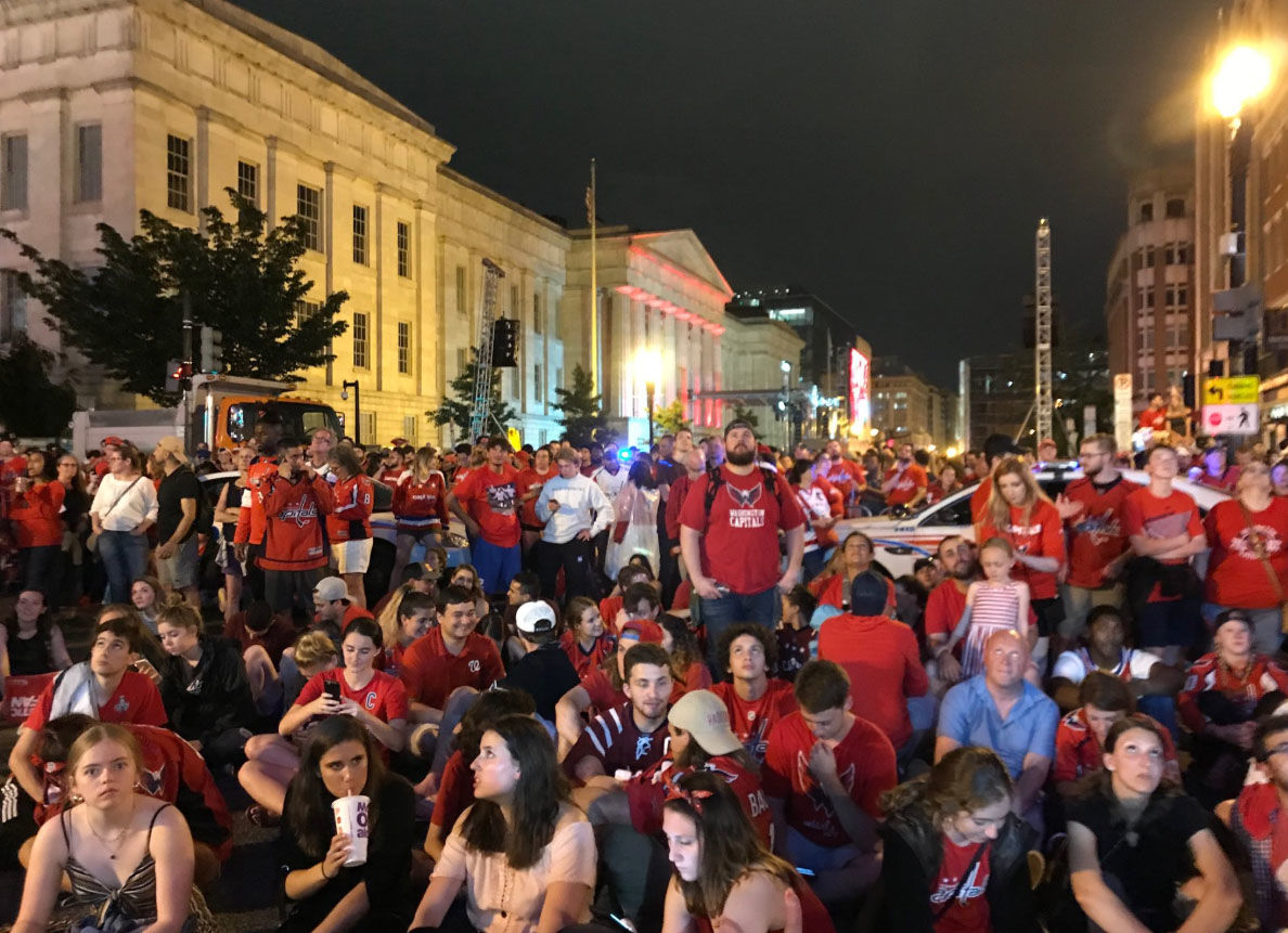 Fans gather outside in Northwest D.C. on Saturday, June 2, 2018, to watch Game 3 of the Stanley Cup final between the Washington Capitals and the Vegas Golden Knights. (WTOP/Dick Uliano)