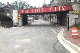 As of 6 a.m. on Tuesday, drivers could cross the Patapsco River bridge from Baltimore County onto Main Street in Ellicott City. Traffic must turn left after one block, on Maryland Ave, but this allows a cut-through. The no access zone remains, in the hardest-hit stretch of Main Street. (WTOP/Neal Augenstein)