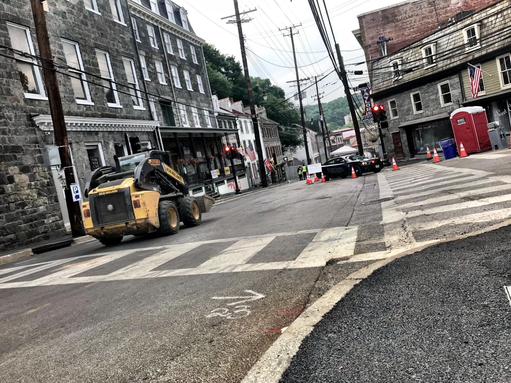 Two-way traffic resumes on Main Street, west of Old Columbia Pike and east of Maryland Avenue. The worst hit stretch of Main Street still limited to access from residents, business owners and property owners. (WTOP/Neal Augenstein)
