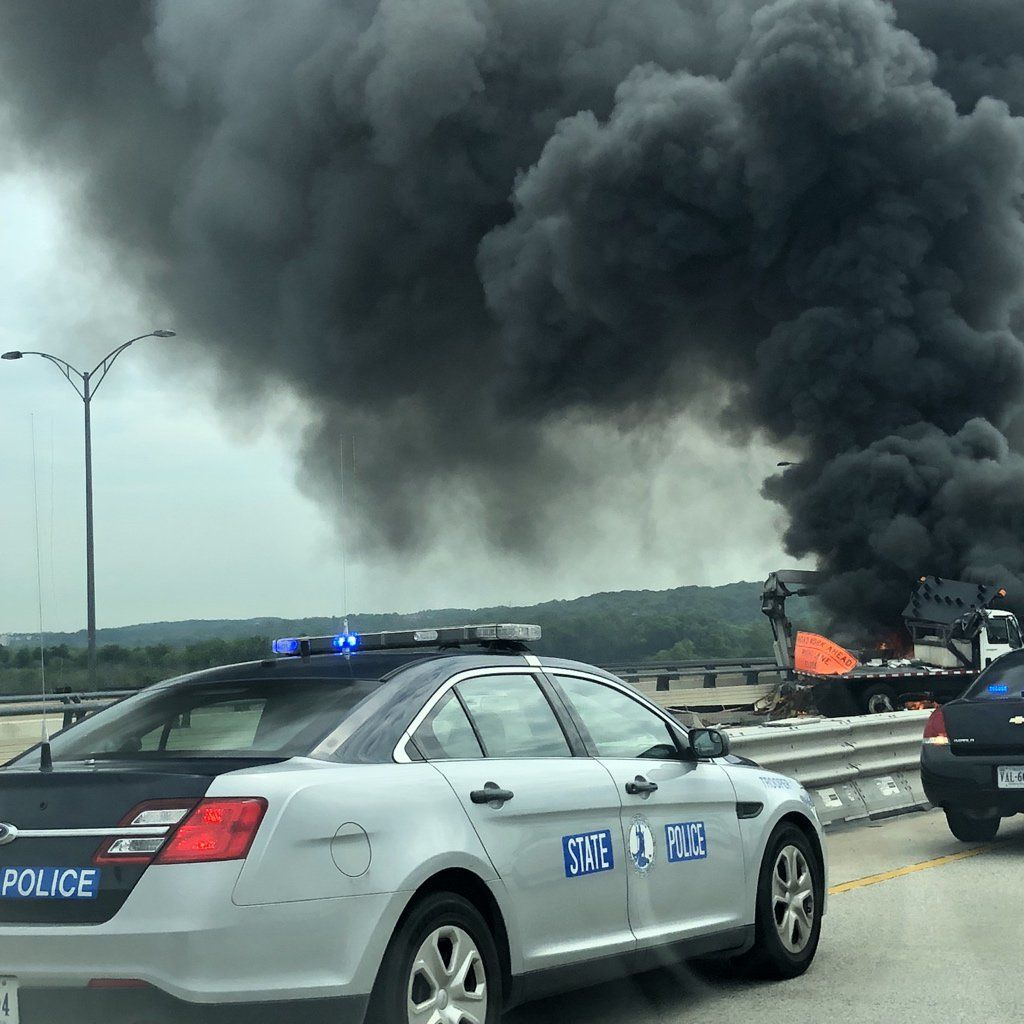 "Wednesday's Wilson Bridge fire apparently began with a collision involving a boom truck. (Courtesy ""Coach Gator"" via Twitter)"