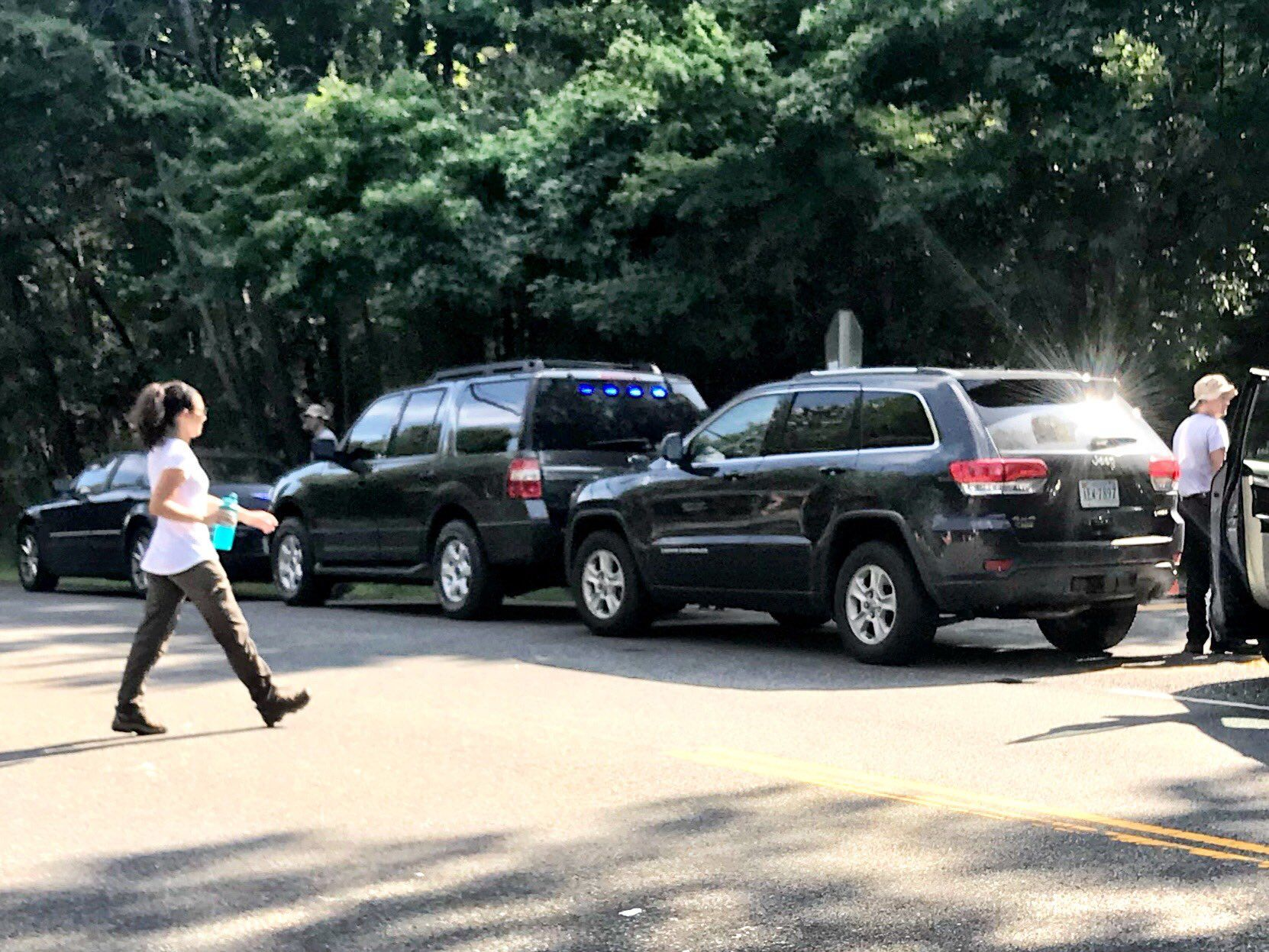 A Jeep Grand Cherokee, similar to what Bijan Ghaisar was driving, has been brought to intersection where he was shot, as part of an FBI crime scene investigation. (WTOP/Neal Augenstein)