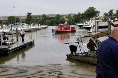 Man dies after car plunges into water at Arlington marina