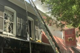 DC Fire and EMS tweeted that the two stores in the 3200 block of O Street Northwest both sustained heavy damage. (Courtesy DC Fire and EMS)