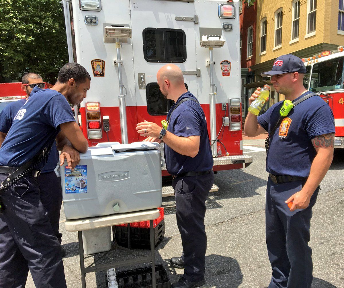 DC Fire and EMS tweeted that the firefighters are undergoing rehabilitation from the intense heat of the day and the fire, and are in the process of re-hydrating and cooling down. (Courtesy DC Fire and EMS)
