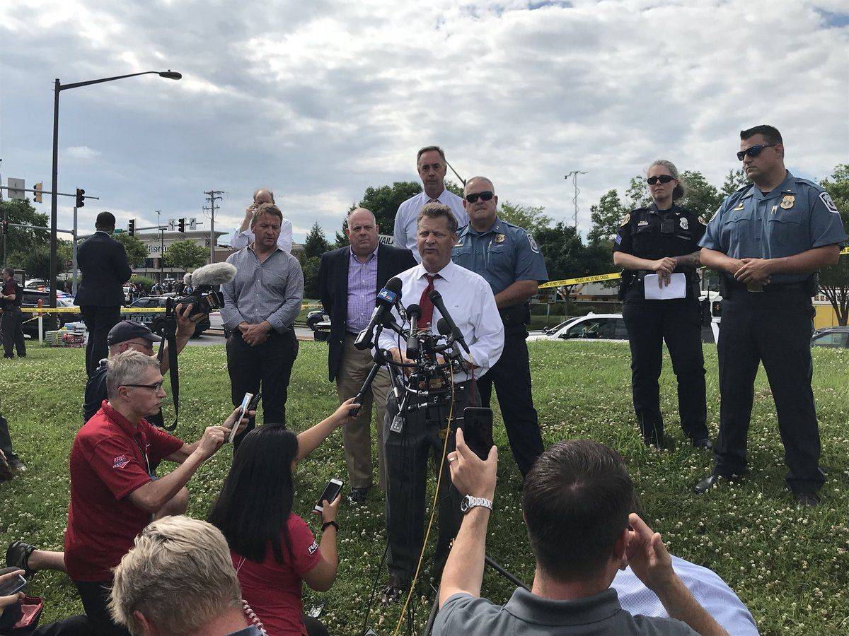 Anne Arundel County Executive Steve Schuh,  flanked by Maryland Gov. Larry Hogan (Left), speaks at a police briefing in the aftermath of an active shooting situation at the Capital Gazette building, 888 Bestgate Road, in Annapolis, Maryland, Thursday afternoon.  (WTOP/Michelle Basch)