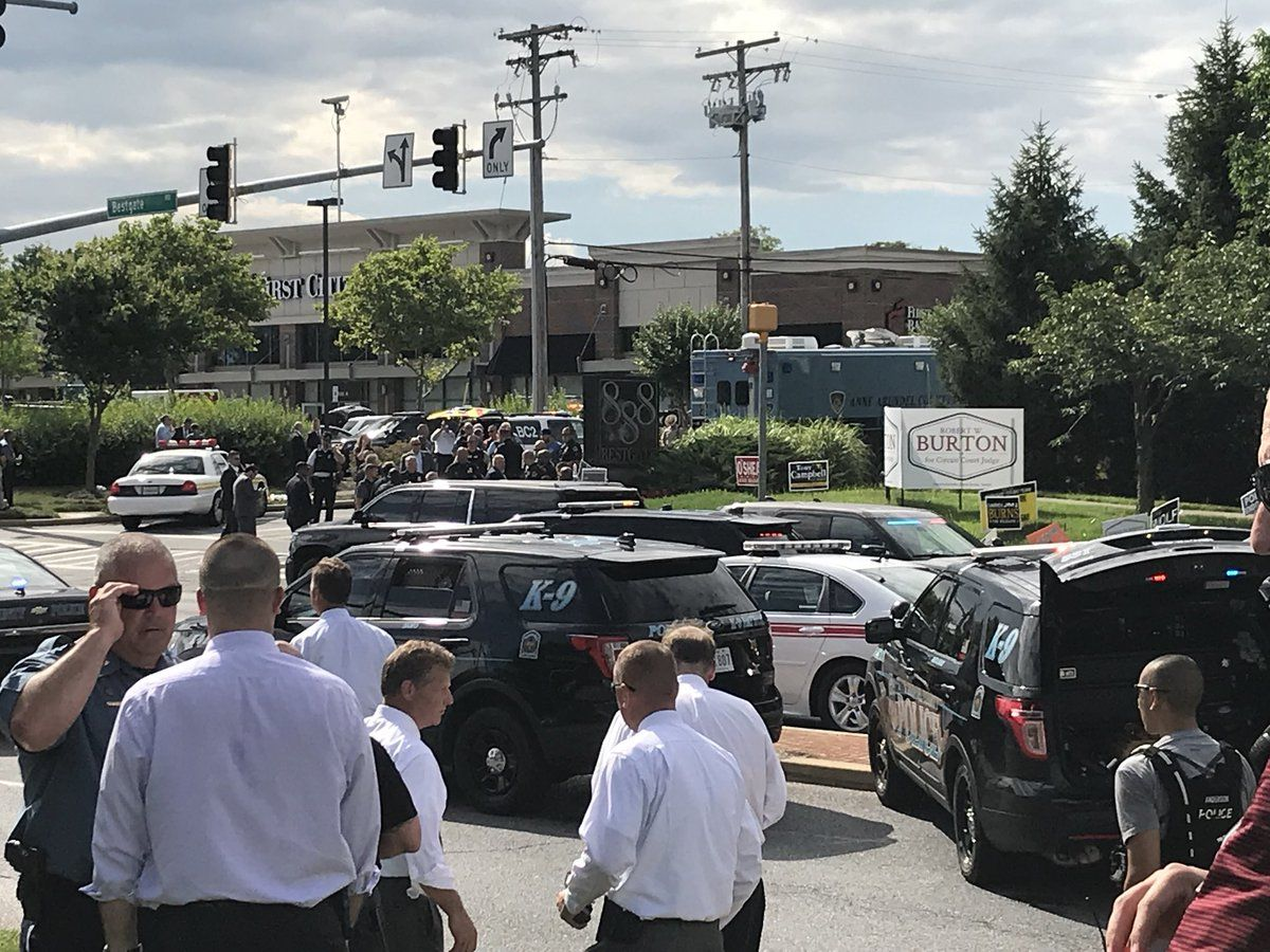 Police blocked a perimeter and held people back from the scene of an active shooting at the Capital Gazette building, 888 Bestgate Road, in Annapolis, Maryland, Thursday afternoon.  (WTOP/Michelle Basch)