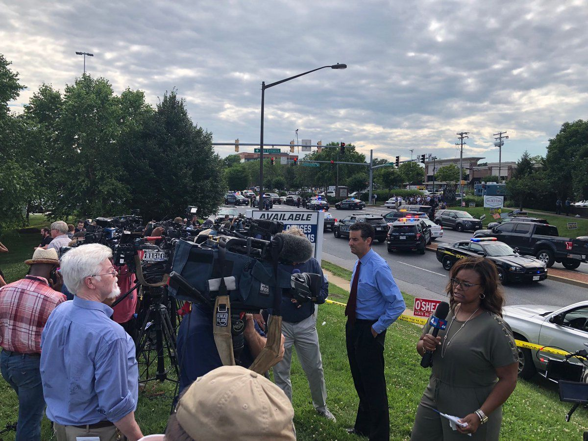 Press and media has set up across the street from the building housing the Capital Gazette, in Annapolis, Maryland. (WTOP/Megan Cloherty)