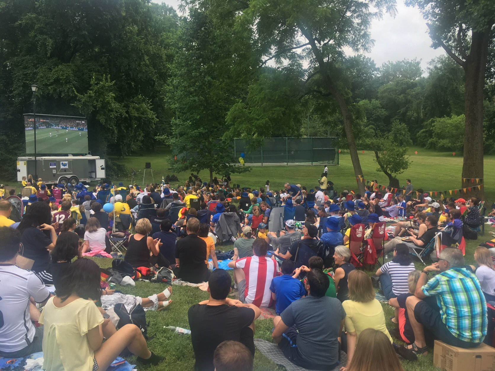The crowd on the lawn of the Swedish Residence Garden taking in Sweden-Germany. (WTOP/Noah Frank)