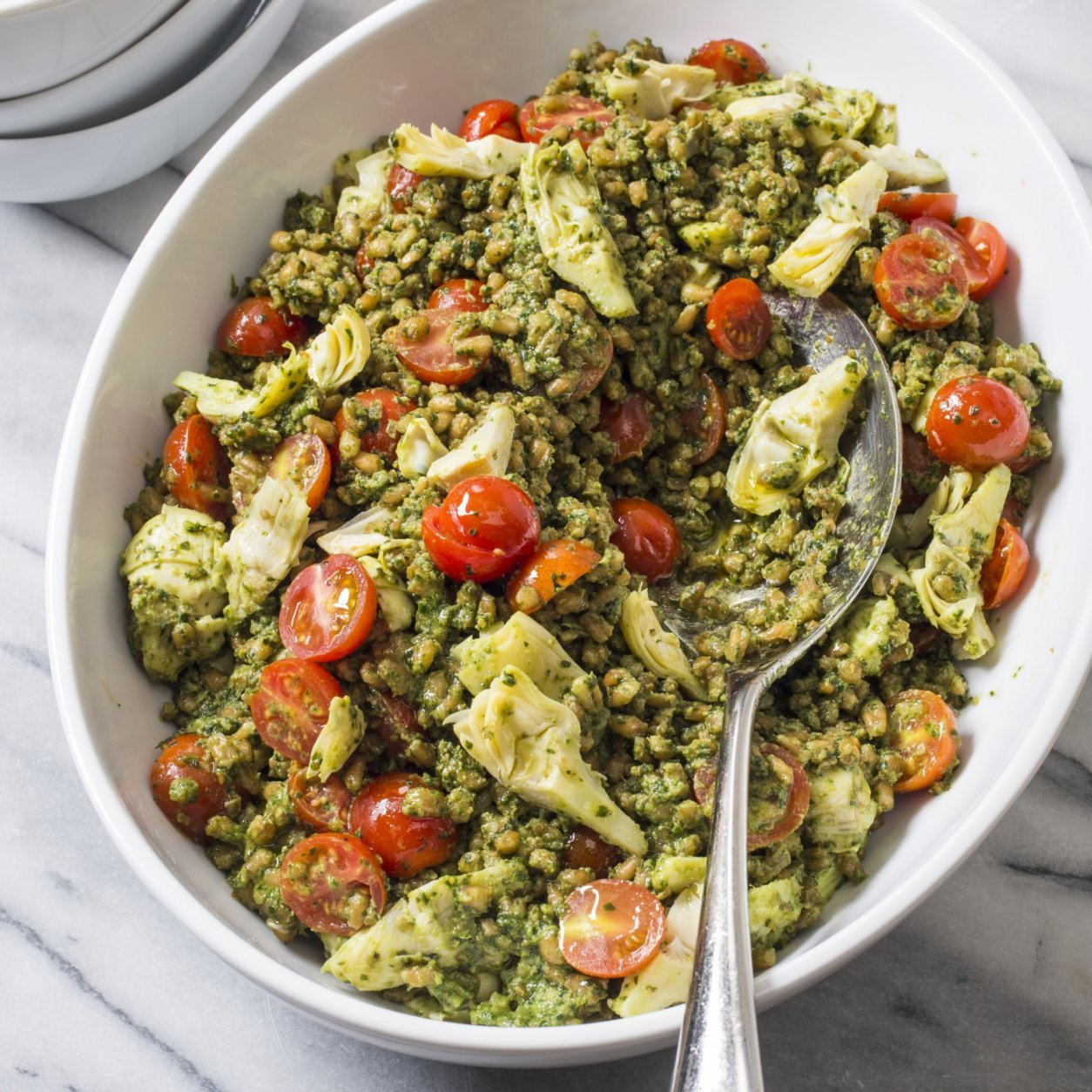 """This undated photo provided by America's Test Kitchen in May 2018 shows pesto farro salad in Brookline, Mass. This recipe appears in the cookbook """"Nutritious Delicious."""" (Carl Tremblay/America's Test Kitchen via AP)"""