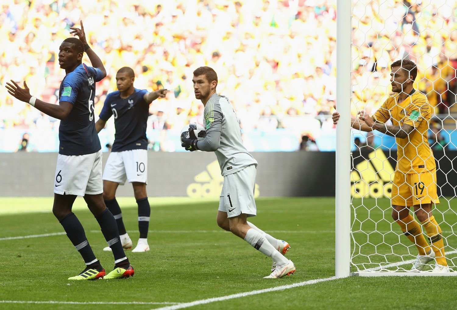 KAZAN, RUSSIA - JUNE 16: Paul Pogba of France celebrates after scoring his side's second goal as Socceroos goalkeeper Mathew Ryan looks on during the 2018 FIFA World Cup Russia group C match between France and Australia at Kazan Arena on June 16, 2018 in Kazan, Russia.  (Photo by Robert Cianflone/Getty Images)