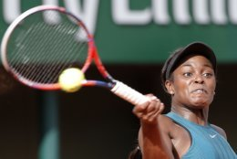 Sloane Stephens of the U.S. slams a forehand to compatriot Madison Keys during their semifinal match of the French Open tennis tournament at the Roland Garros stadium, Thursday, June 7, 2018 in Paris. (AP Photo/Michel Euler)