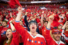 WASHINGTON, DC - JUNE 07: A Washington Capitals fans cheer during the fan watch party at Capitol One Area on June 7, 2018 in Washington, DC. The Washington Capitals head into Game 5 tonight against the Las Vegas Golden Knights with a  3-1 series lead. (Photo by Alex Edelman/Getty Images)