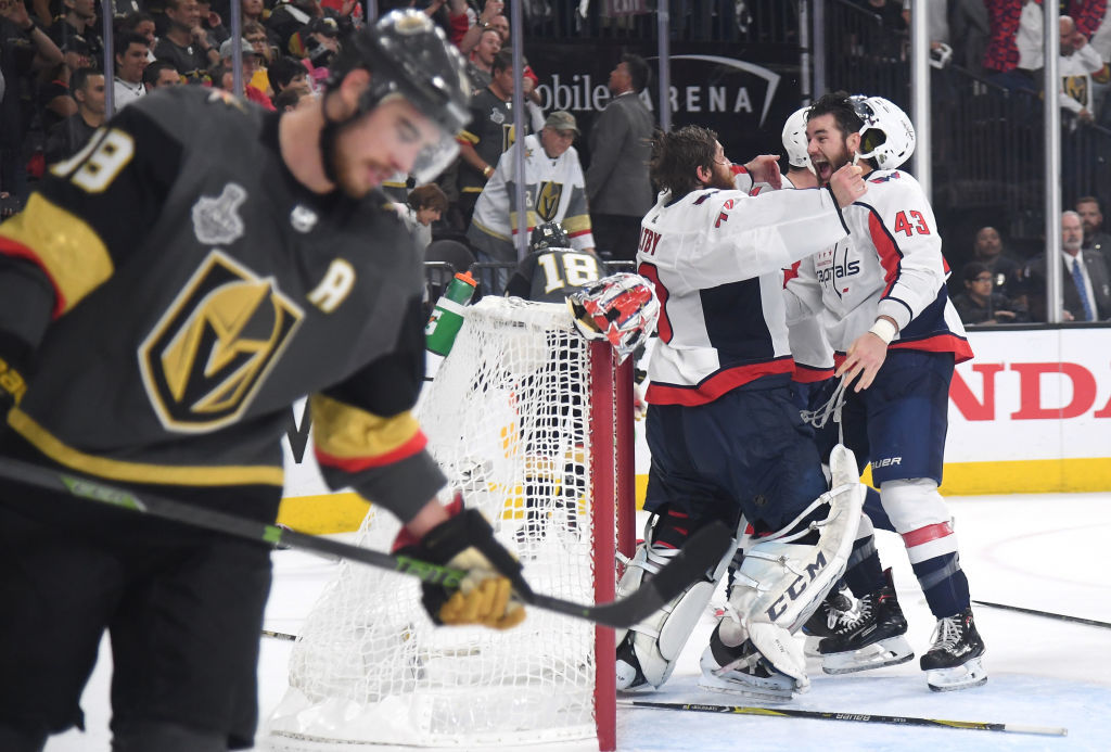 LAS VEGAS, NV - JUNE 07:  Braden Holtby #70 and Tom Wilson #43 of the Washington Capitals celebrate their 4-3 winto win the Stanley Cup as Reilly Smith #19 of the Vegas Golden Knights reacts in Game Five of the 2018 NHL Stanley Cup Final at T-Mobile Arena on June 7, 2018 in Las Vegas, Nevada.  (Photo by Harry How/Getty Images) *** Local Caption *** Reilly Smith; Braden Holtby; Tom Wilson