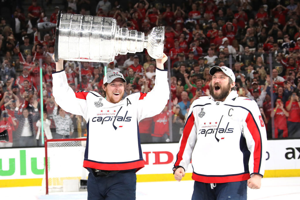 LAS VEGAS, NV - JUNE 07:  Alex Ovechkin #8 hands of the Stanley Cup to Nicklas Backstrom #19 of the Washington Capitals after their team's 4-3 win over the the Vegas Golden Knights in Game Five of the 2018 NHL Stanley Cup Final at T-Mobile Arena on June 7, 2018 in Las Vegas, Nevada.  (Photo by Bruce Bennett/Getty Images) *** Local Caption *** Nicklas Backstrom; Alex Ovechkin