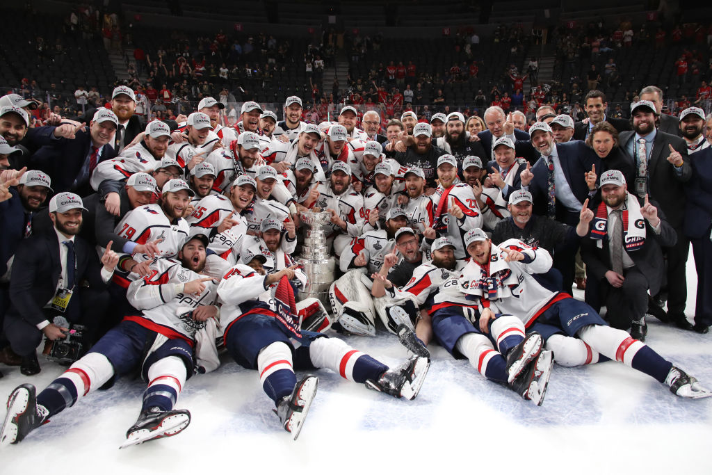 LAS VEGAS, NV - JUNE 07:  The Washington Capitals pose for a photo with the Stanley Cup after their team's 4-3 win over the Vegas Golden Knights in Game Five of the 2018 NHL Stanley Cup Final at T-Mobile Arena on June 7, 2018 in Las Vegas, Nevada.  (Photo by Bruce Bennett/Getty Images)