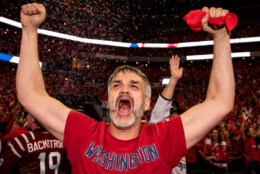 WASHINGTON, DC - JUNE 07: A Washington Capitals fan celebrates after the Washington Capitals win Game 5 of the Stanley Cup Final against the Vegas Golden Nights to capture the Stanley Cup during a watch party at Capitol One Area on June 7, 2018 in Washington, DC. The Washington Capitals defeated the Vegas Golden Knights 4-3. (Photo by Alex Edelman/Getty Images)