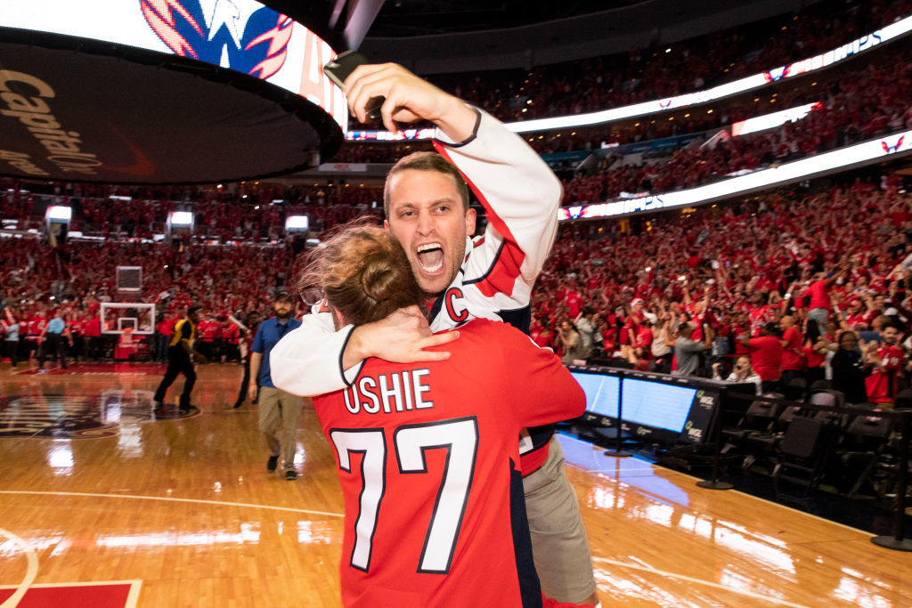 WASHINGTON, DC - JUNE 07: Washington Capitals fans celebrate after the Washington Capitals win Game 5 of the Stanley Cup Final against the Vegas Golden Nights to capture the Stanley Cup during a watch party at Capitol One Area on June 7, 2018 in Washington, DC. The Washington Capitals defeated the Vegas Golden Knights 4-3. (Photo by Alex Edelman/Getty Images)
