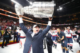 LAS VEGAS, NV - JUNE 07:  Head coach Barry Trotz of the Washington Capitals hoists the Stanley Cup after his team defeated the Vegas Golden Knights 4-3 in Game Five of the 2018 NHL Stanley Cup Final at T-Mobile Arena on June 7, 2018 in Las Vegas, Nevada.  (Photo by Bruce Bennett/Getty Images) *** Local Caption *** Barry Trotz