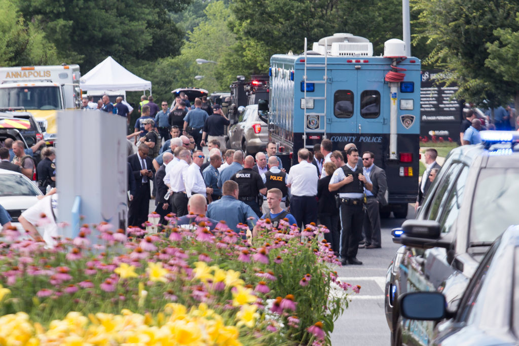 ANNAPOLIS, MARYLAND - JUNE 28:  Emergency personnel congregate outside the Capital-Gazette newspaper building on June 28, 2018 in Annapolis, Maryland. Five people were killed when a gunman opened fire in the newsroom, according to published reports. One person is in custody.  (Photo by Alex Wroblewski/Getty Images)