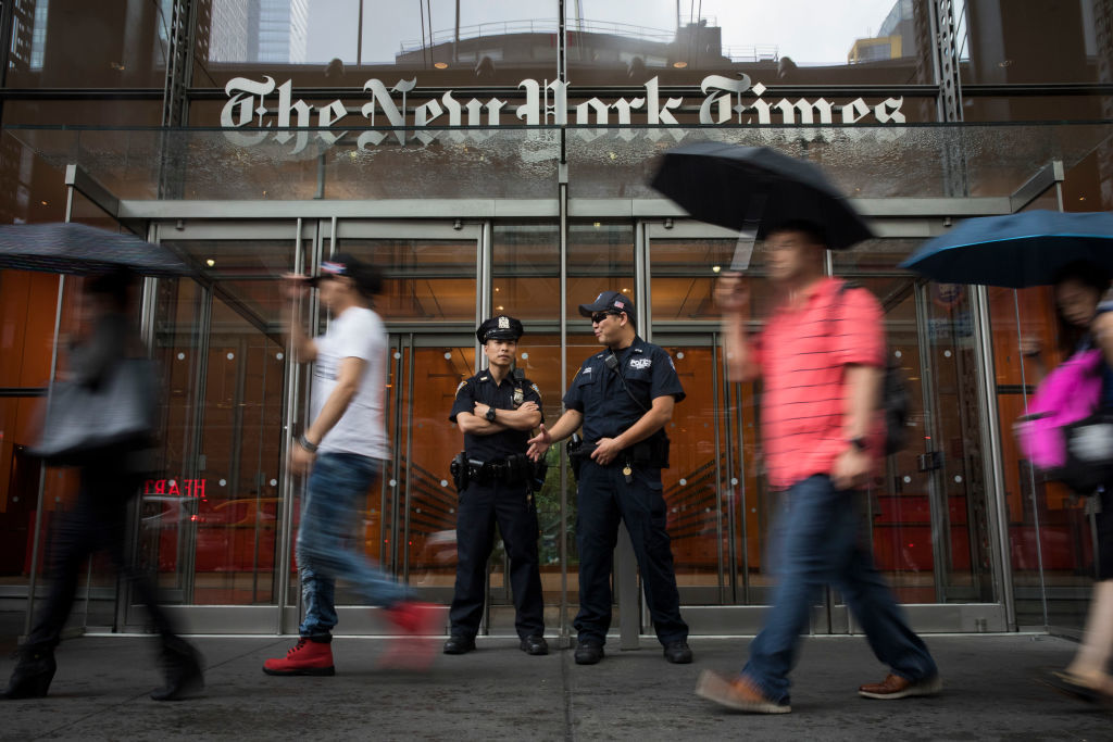 NEW YORK, NY - JUNE 28: Members of the New York City Police Department stand outside the headquarters of The New York Times, June 28, 2018 in New York City. NYPD announced increased security in Manhattan at major media companies following a shooting today at the Capital Gazette newspaper in Maryland. (Photo by Drew Angerer/Getty Images)