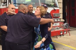 Victoria Wolf of Crofton, Maryland, thanks members of Engine Company 3 who responded when she went into cardiac arrest Aug. 14. (WTOP/Kristi King)