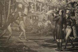 The Alexander Hamilton exhibit at Smithsonian National Postal Museum in Washington, Monday, June 11, 2018, displays an image of the then-Vice President Aaron Burr and Hamilton duel at Weehawken, New Jersey, July 11, 1804, showing Burr, right, taking aim at Hamilton left, who fires into the air. The blockbuster show Hamilton is finally coming to the nation's capital and the city is preparing in ways that only Washington can. (AP Photo/Manuel Balce Ceneta)
