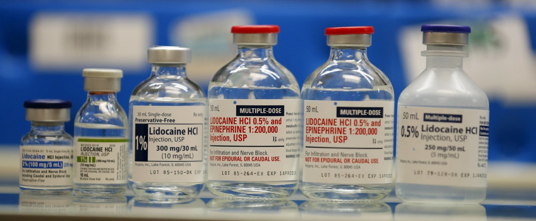 In this Friday, June 1, 2018, photo, vials of the local anesthetic lidocaine, currently in short supply, are shown in the inpatient pharmacy at the University of Utah Hospital in Salt Lake City. Amid the nation's opioid epidemic, hospitals are struggling to get widely used injected pain medicines because of ongoing supply shortages. The shortages affect just about every corner of the hospital, from the operating room and emergency department. (AP Photo/Rick Bowmer)